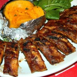 Full slab of babyback ribs with baked sweet potato