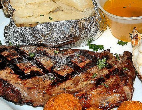 New York strip steak and baked potato