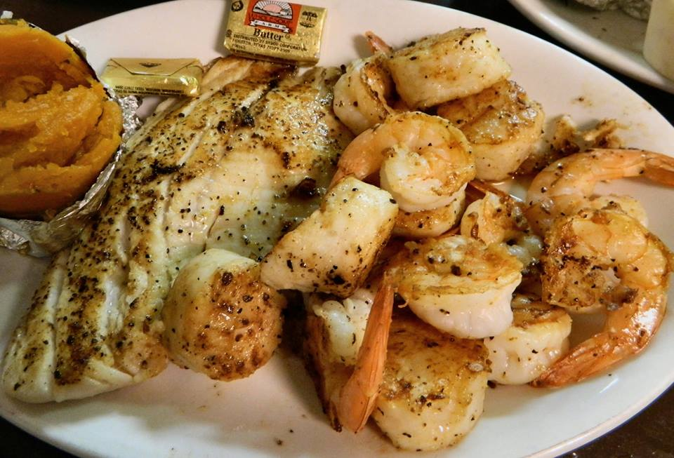 Griled seafood compbo consisting of fish, shrimp and scallops