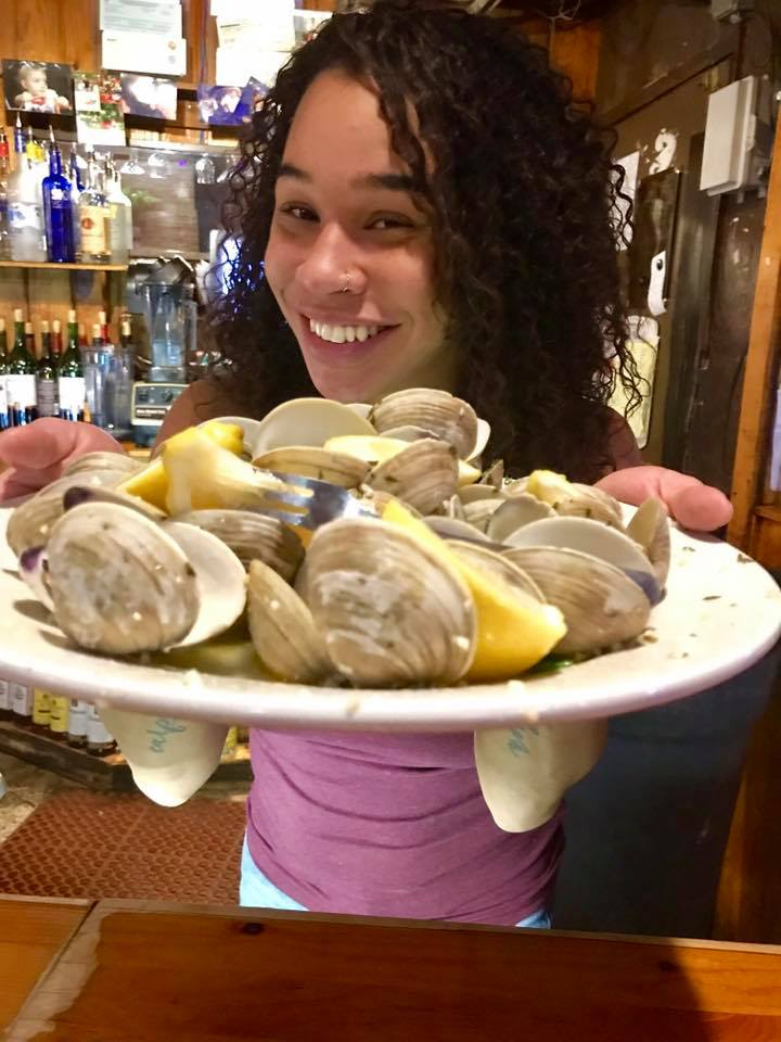 beautifil Alexandra showing an appetizer of steamed clams