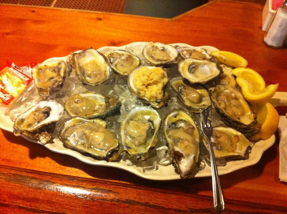 Raw oysters on the half shell with horse radish and saltine crackers